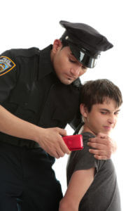 Police officer with teen juvenile delinquent